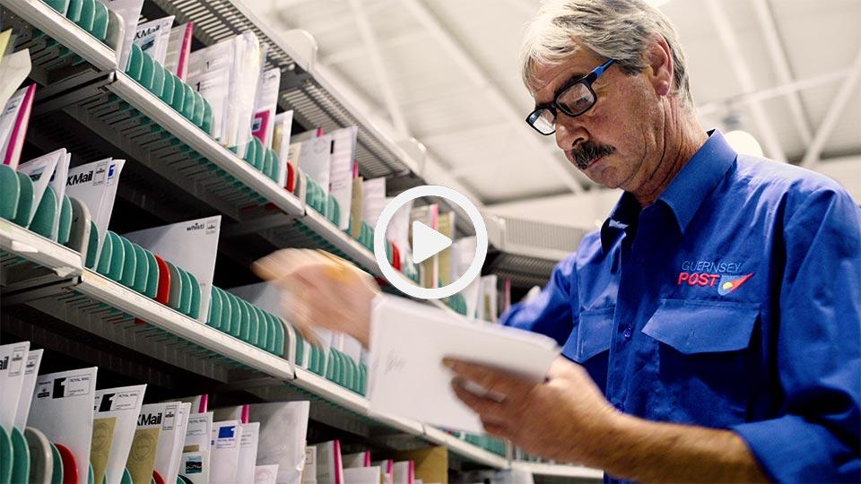postman sorting mail